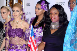 Kimma Wreh celebrates her Liberian heratage by waving the country flag durning fashion week press gathering.